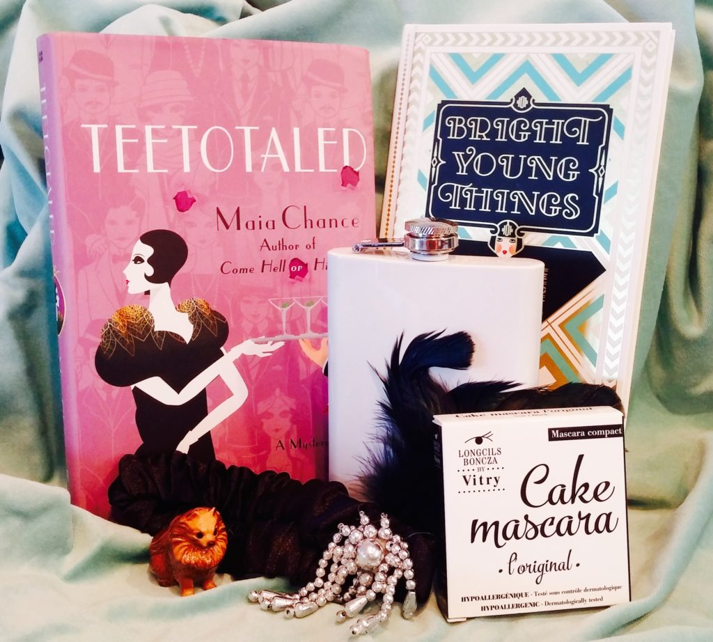 This prize pack is the bee's knees. Enter to win an autographed copy of TEETOTALED, a copy of the wonderful BRIGHT YOUNG THINGS: A MODERN GUIDE TO THE ROARING 20s, Longcils Brncza cake mascara, a vintage porcelain Pomeranian, a flask, and a blingy feathered flapper headdress!